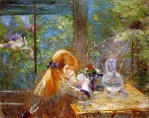 Red haired girl sitting on a veranda