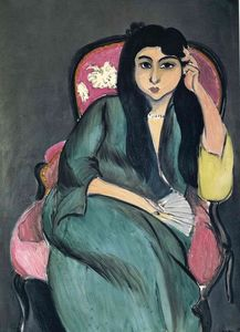 Laurette in Green in a Pink Chair