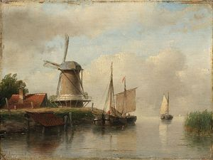 Dutch Boats Moored On A River Next To A Windmill