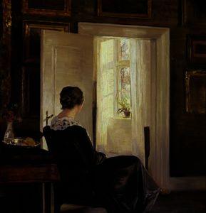 A woman seated near a door
