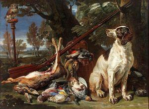 Trofeo del cazador con un perro y un búho.