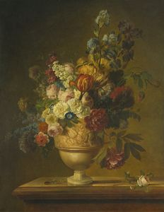 Flowers in a basket on a marble ledge