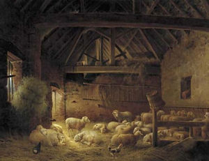 A flock of sheep in a stable