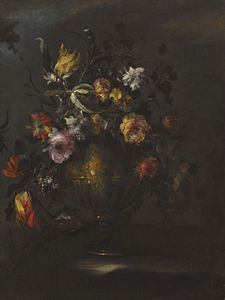 A still life of roses, tulips and other flowers in a bronze vase on a stone ledge