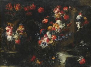 An ornate still life with flowers in vases on a stone ledge