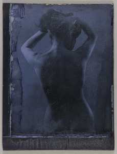 Untitled (torso length, rear view, standing female nude holding hair off of neck)