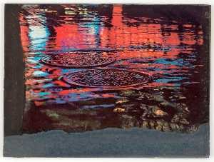 Untitled (red and blue reflections on sewer covers in wet street)