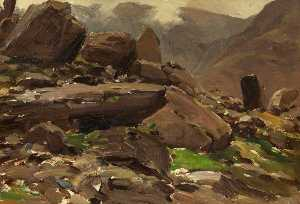 A Mountainous Lake Scene with Rocks in the Foreground
